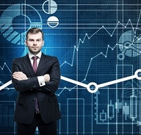 Front view of the handsome manager with crossed hands. Financial analytic charts are drawn on the background.